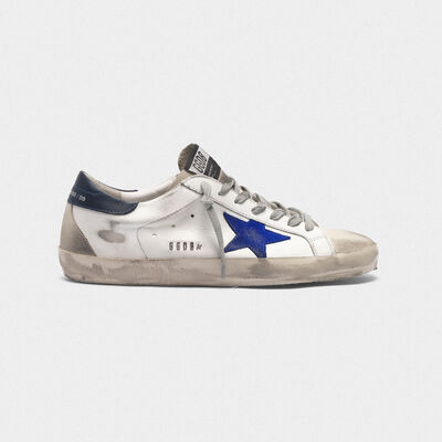 White Superstar sneakers with electric blue star