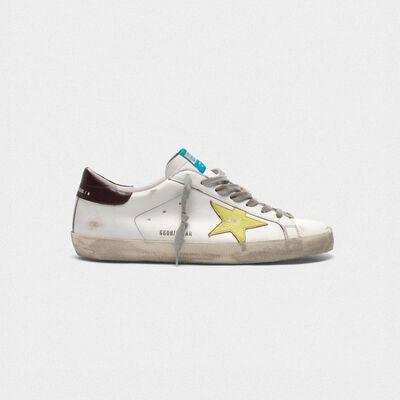 Sneakers Superstar con stella gialla talloncino burgundy