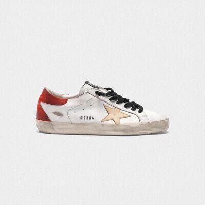 White Superstar sneakers with red rear and black laces