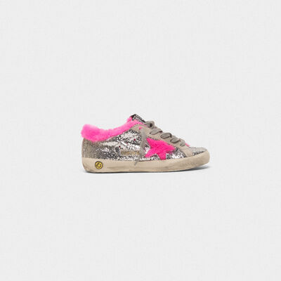 Sneakers Superstar in glitter con interno in shearling fuxia