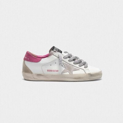 White superstar sneakers with fuchsia lizard-print heel tab