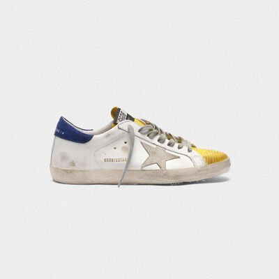 Two-tone Superstar sneakers with yellow lizard-print insert