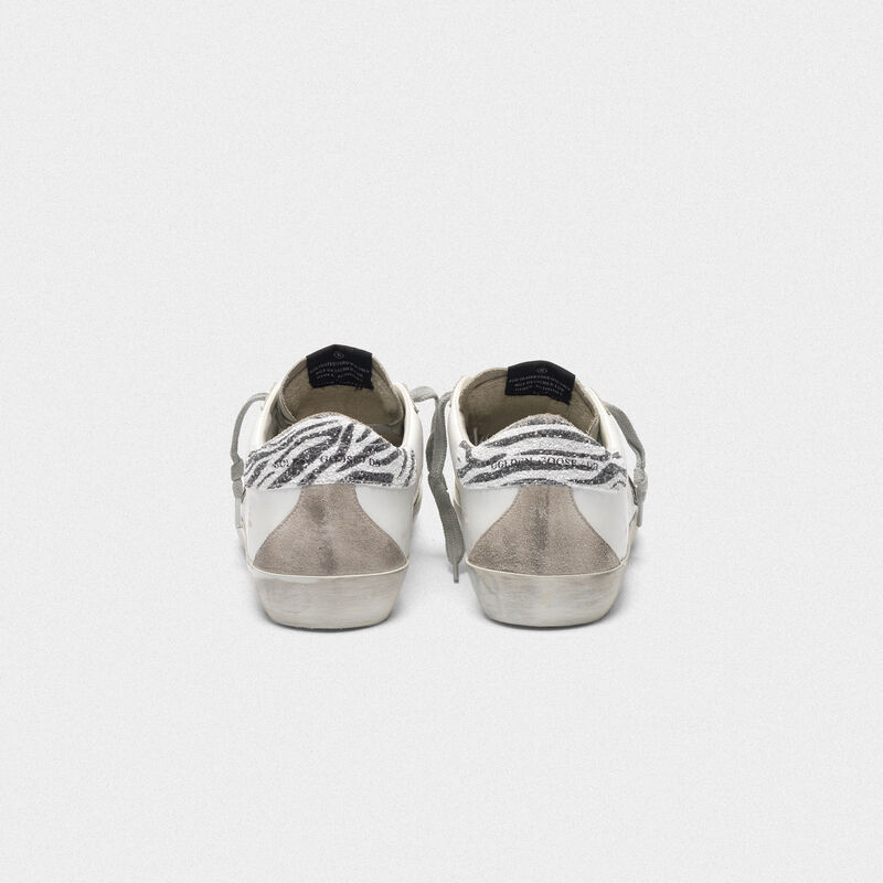 Golden Goose - Sneakers Superstar con stella leopardata e talloncino zebrato in  image number null