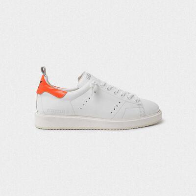White Starter sneakers with fluorescent orange heel tab