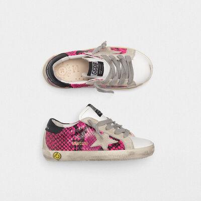 Sneakers Superstar bianche e fuxia pitonate
