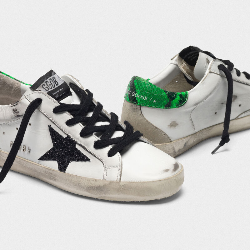 Golden Goose - Superstar sneakers with glittery black star and snakeskin-print heel tab in  image number null