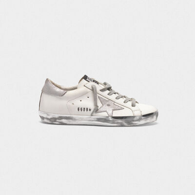 Superstar sneakers with silver sparkle foxing and metal stud lettering