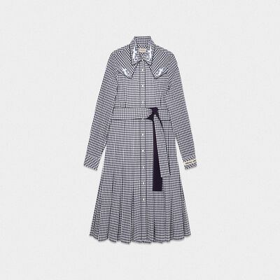 Olivia dress with black and white checks and cowboy-style decorations