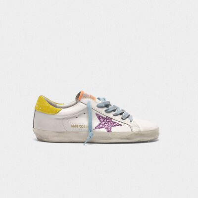 Superstar sneakers with pink glittery star and yellow heel tab
