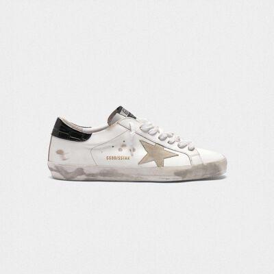 White Superstar sneakers with black croc-print heel tab
