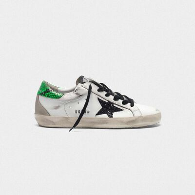 Superstar sneakers with glittery black star and snakeskin-print heel tab