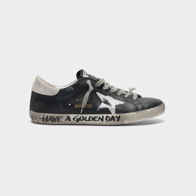 Black Superstar sneakers with handwritten lettering