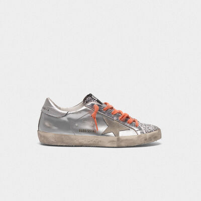 Superstar sneakers in silver laminated leather and glitter