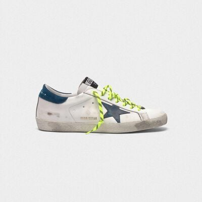 White Superstar sneakers with fluorescent trekking laces