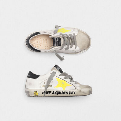Superstar sneakers with painted star and lettering on the foxing