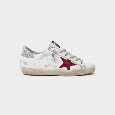 White Superstar sneakers in leather with glittery red star