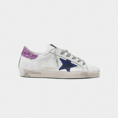 White Superstar sneakers with blue star and glittery heel tab