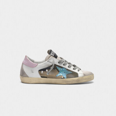 Camouflage Superstar sneakers with glittery star and pink heel tab