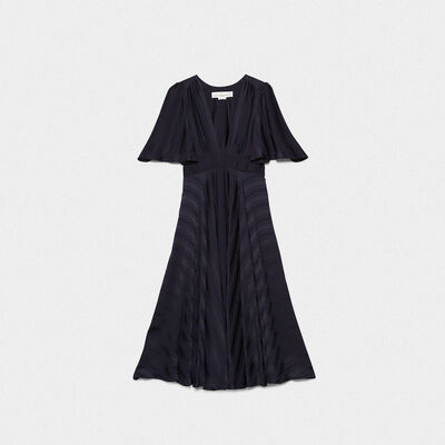 Hana dress with belt at the waist and ruffles on the back