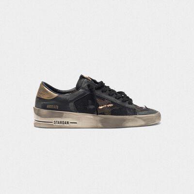 Distressed black and gold Stardan LTD sneakers