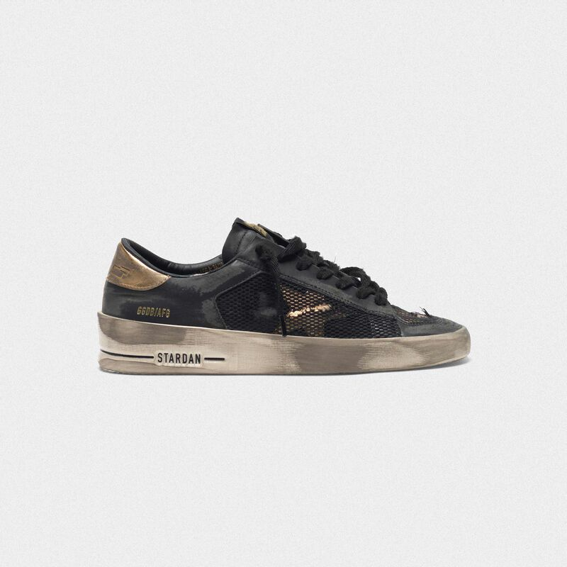 Golden Goose - Distressed black and gold Stardan LTD sneakers  in  image number null