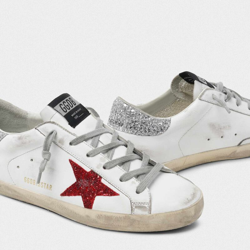 Golden Goose - White Superstar sneakers in leather with glittery red star in  image number null