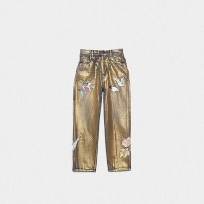 Jeans Kim con stampa laminata e decorazioni
