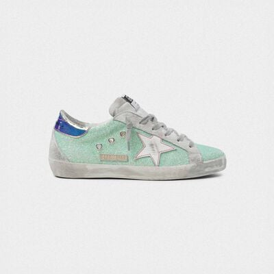 Superstar sneakers with green glitter and chrome heel tab